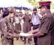 Sri Lankan chief General Lionel Balagalle presents a certificate to Major Rita Prasad at the Sri Lankan army headquarters in Colombo.